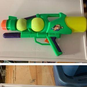 Water gun, chalk, 2 frisbees, and bouncy balls